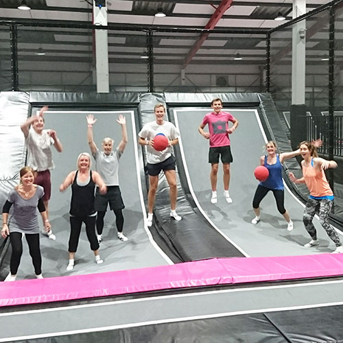 "The SUP Bristol team on ""staff training"" at a local trampoline park"