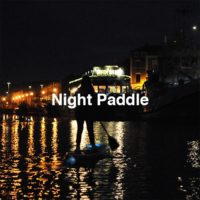 Paddle boarding at night in Bristol Floating Harbour