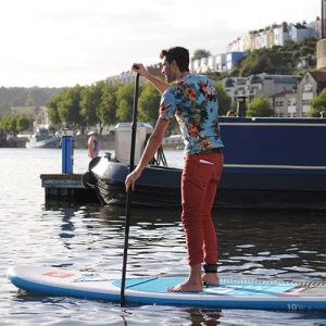 Man paddling in Bristol harbour on SUP
