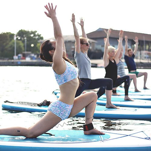 Stand up paddleboard yoga with SUP Bristol and Trika